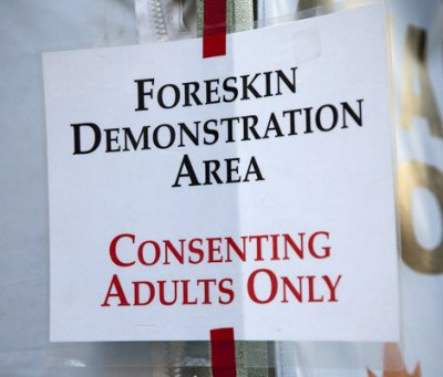 Sign reading 'Foreskin Demonstration Area'